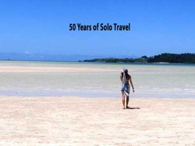 Solo Travel Savings Tips-Beach Solo with Book Title