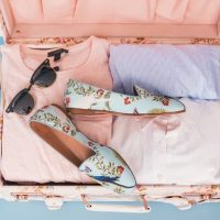 Ways to Look Chic for Less While Traveling - Open Suitcase