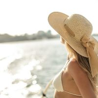 Ways to Look Chic for Less While Traveling Stylish Woman in Hat